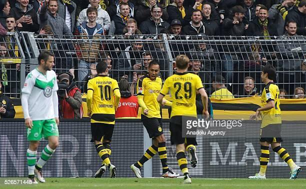 Borussia Dortmund's Henrikh Mkhitaryan PierreEmerick Aubameyang Marcel Schmelzer and Shinji Kagawa celebrate a goal during their Bundesliga soccer...