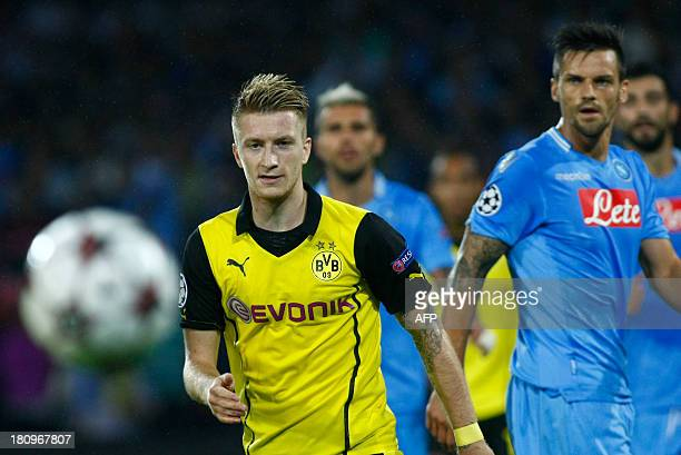 Borussia Dortmund's Marco reus and Napoli's Christian Maggio eye the ball during the group F Champions League football match SSC Napoli vs Borussia...