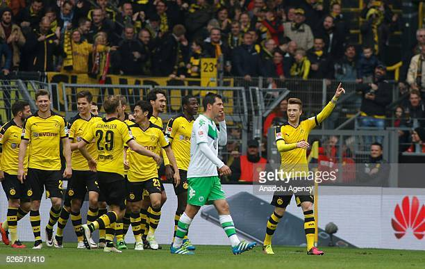 Borussia Dortmund's Marco Reus celebrates a goal during their Bundesliga soccer match between Borussia Dortmund and VfL Wolfsburg at the SignalIduna...