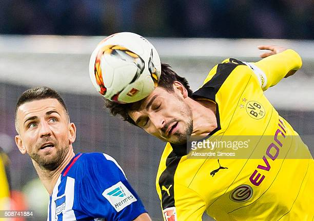 Borussia Dortmund's Mats Julian Hummels challenges Weda Ibisevic of Hertha in an aerial duel during the Bundesliga match between Hertha BSC and...