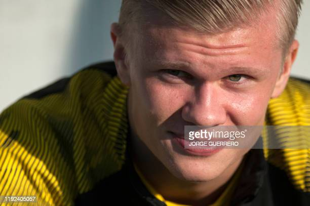 Borussia Dortmund's Norwegian forward Erling Braut Haland sits on the bench during the friendly football match between Standard Liege and Borussia...