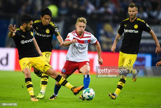 Borussia Dortmund's Nuri Sahin Shinji Kagawa and Andrej Jarmolenko battle for the ball with Hamburg SV's Lewis Holtby during the German Bundesliga...