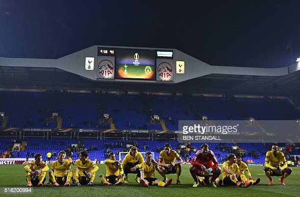 Borussia Dortmund's players celebrate on the pitch after the UEFA Europa League round of 16 second leg football match between Tottenham Hotspur and...