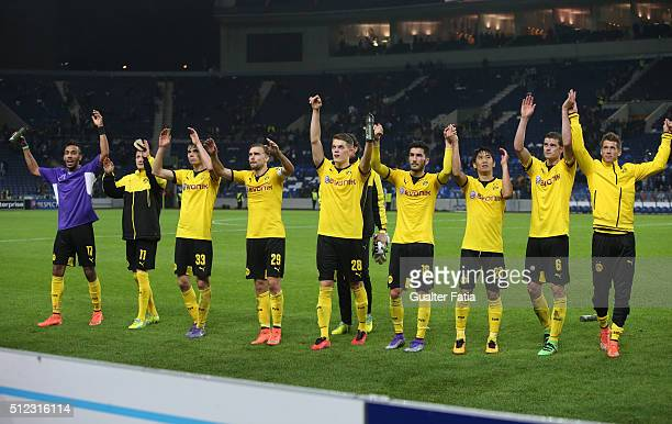 Borussia Dortmund's players celebrate with supporters at the end of the UEFA Europa League Round of 32 Second Leg match between FC Porto and Borussia...