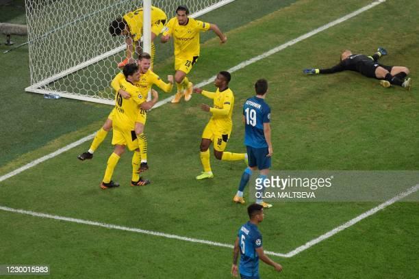 Borussia Dortmund's Polish defender Lukasz Piszczek celebrates after scoring the team's first goal during the UEFA Champions League football match...