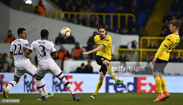 Borussia Dortmund's Serbian defender Neven Subotic has an unsuccessful shot during the UEFA Europa League round of 16 second leg football match...