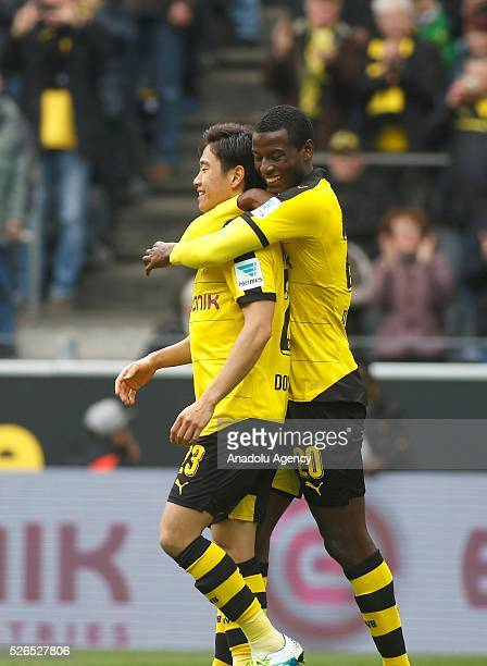 Borussia Dortmund's Shinji Kagawa and Adrian Ramos celebrate a goal during their Bundesliga soccer match between Borussia Dortmund and VfL Wolfsburg...