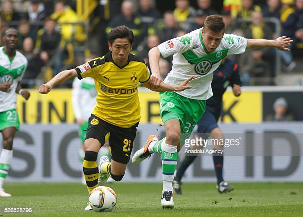 Borussia Dortmund's Shinji Kagawa and VfL Wolfsburg's Robin Knoche in action during their Bundesliga soccer match between Borussia Dortmund and VfL...