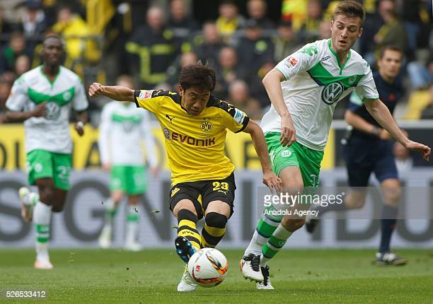 Borussia Dortmund's Shinji Kagawa and VfL Wolfsburg's Robin Knoche during their Bundesliga soccer match between Borussia Dortmund and VfL Wolfsburg...