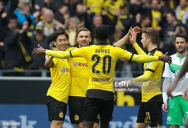 Borussia Dortmund's Shinji Kagawa Marcel Schmelzer Adrian Ramos and Marco Reus celebrate a goal during their Bundesliga soccer match between Borussia...
