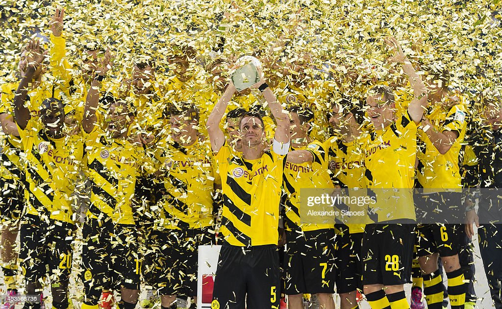 Borussia Dortmund's team with the SuperCup trophy during the victory ceremony after the DFL Supercup match between Borussia Dortmund and FC Bayern Muenchen at Signal Iduna Park on August 13, 2014 in Dortmund, Germany.