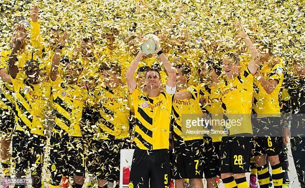Borussia Dortmund's team with the SuperCup trophy during the victory ceremony after the DFL Supercup match between Borussia Dortmund and FC Bayern...