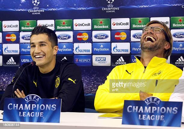 Borussia Dortmund's Turkish midfielder Nuri Sahin and coach Jurgen Klopp give a press conference on September 17 2013 at the San Paolo stadium in...