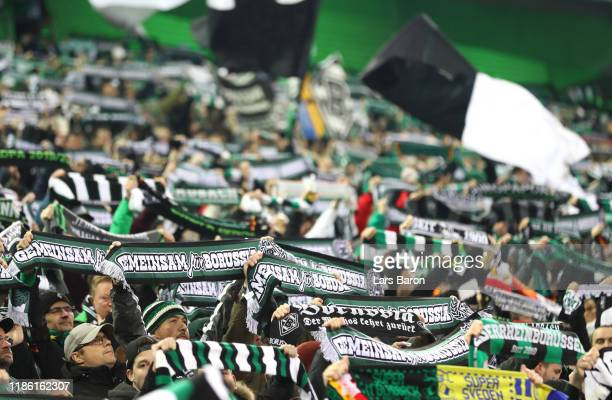 Borussia fans hold scarves up in the air during the UEFA Europa League group J match between Borussia Moenchengladbach and AS Roma at Borussia-Park...