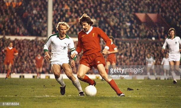 Borussia Mönchengladbach full back Berti Vogts challenges Liverpool winger Steve Heighway during the European Cup Semi Final 2nd leg match at Anfield...