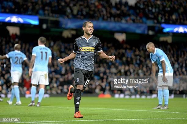 Borussia Mochengladbach's Raffael celebrates scoring his team's second goal during the UEFA Champions League Group D soccer match between Manchester...