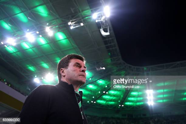Borussia Moenchengladbach coach Dieter Hecking looks on during the UEFA Europa League Round of 32 first leg match between Borussia Moenchengladbach...