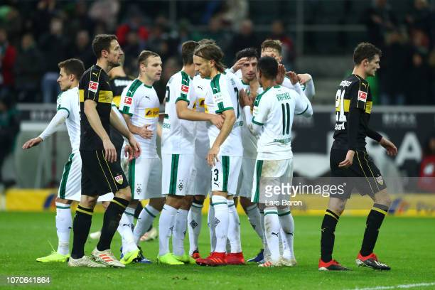 Borussia Moenchengladbach players celebrate as Benjamin Pavard of VfB Stuttgart scores an own goal for their third during the Bundesliga match...