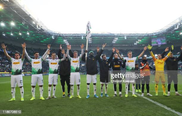 Borussia Moenchengladbach players celebrate victory after the Bundesliga match between Borussia Moenchengladbach and SV Werder Bremen at BorussiaPark...