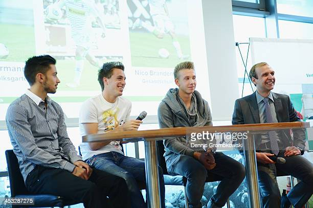 Borussia Moenchengladbach players Julian Korb Patrick Herrmann and Nico Brandenburger are interviewed by Thorsten Knippertz during the DFB Football...