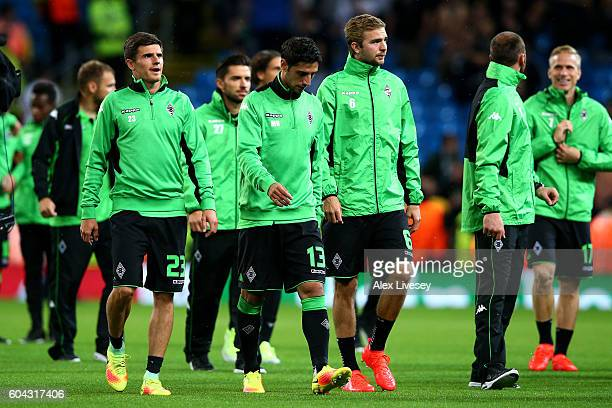 Borussia Moenchengladbach players look on following the postponement of the UEFA Champions League Group A match between Manchester City FC and VfL...