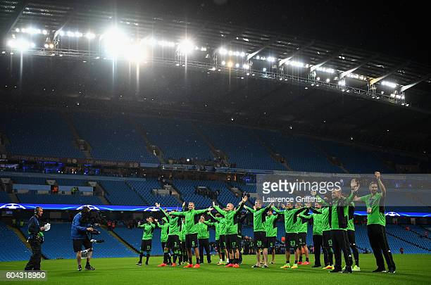 Borussia Moenchengladbach players salute their travelling fans following the postponement of the UEFA Champions League Group A match between...