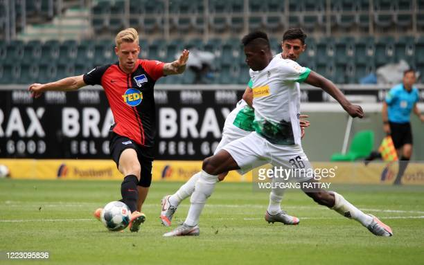 Borussia Moenchengladbach's Breel Embolo fights for the ball during the German first division Bundesliga football match between Borussia...