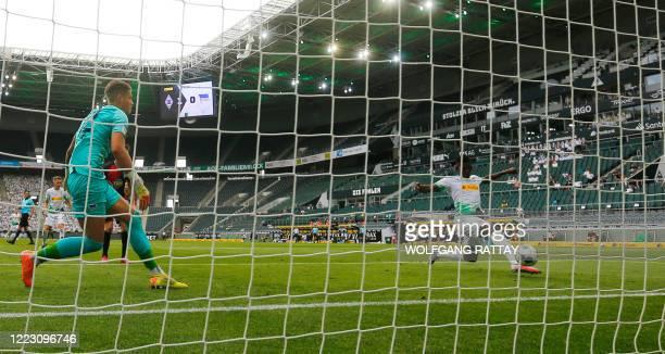 Borussia Moenchengladbach's Breel Embolo scores their second goal during the German first division Bundesliga football match Borussia...
