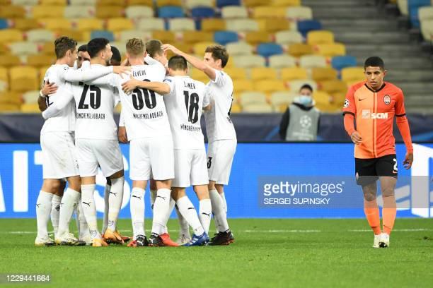 Borussia Moenchengladbach's French forward Alassane Plea celebrates scoring his team's third goal during the UEFA Champions League football match...