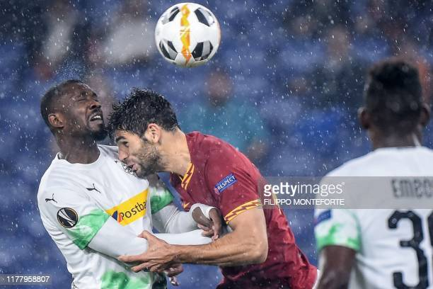 Borussia Moenchengladbach's French forward Marcus Thuram and AS Roma's Argentinian defender Federico Fazio go for a header during the UEFA Europa...