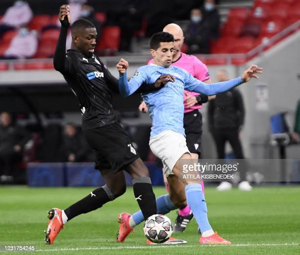 Borussia Moenchengladbach's Swiss forward Breel Embolo vies with Manchester City's Portuguese defender Joao Canceloduring the UEFA Champions League,...