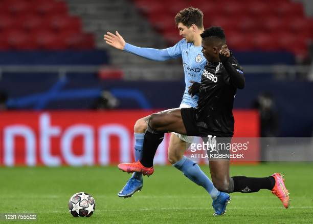 Borussia Moenchengladbach's Swiss forward Breel Embolo vies with Manchester City's English defender John Stones during the UEFA Champions League,...