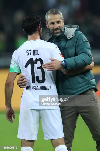 Borussia Monchengladbach manager / head coach Marco Rose gives his players celebrates with Lars Stindl the Bundesliga match between Borussia...