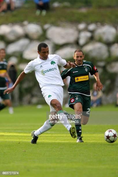 Borussia Monchengladbach's Oliver Neuville and Panathinaikos Athens's Gilberto Silva battle for the ball