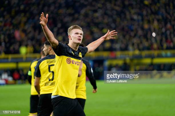 Borussia's Erling Braut Haaland celebrates after scoring his 2nd goal during the UEFA Champions League round of 16 first leg match between Borussia...