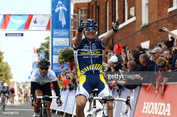 Borut Bozic of Slovenia and team Vacansoleil Pro Cycling celebrates crossing the line in first during Stage Seven of the Tour of Britain on September...