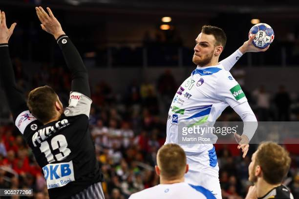 Borut Mackovsek of Slovenia is challenged by Hendrik Pekeler of Germany during the Men's Handball European Championship Group C match between...