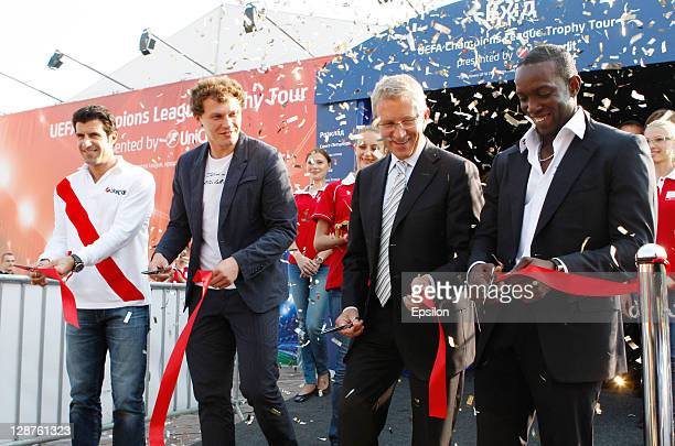 Borys Tymonkin CEO of the UniCredit Bank cuts the ribbon to open the UEFA Champions League Trophy Tour with Luis Figothe Official UniCredit...
