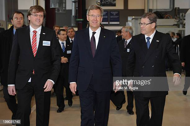Bosch Bari CEO Rupert Hoellbacher President of Germany Christian Wulff and Supervisory Board Chairman of Robert Bosch GmbH Hermann Scholl walk during...