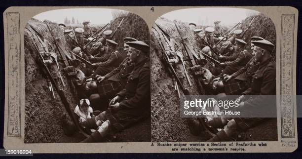 A Bosche sniper worries a Section of Seaforths who are snatching a moment's respite ca 1916