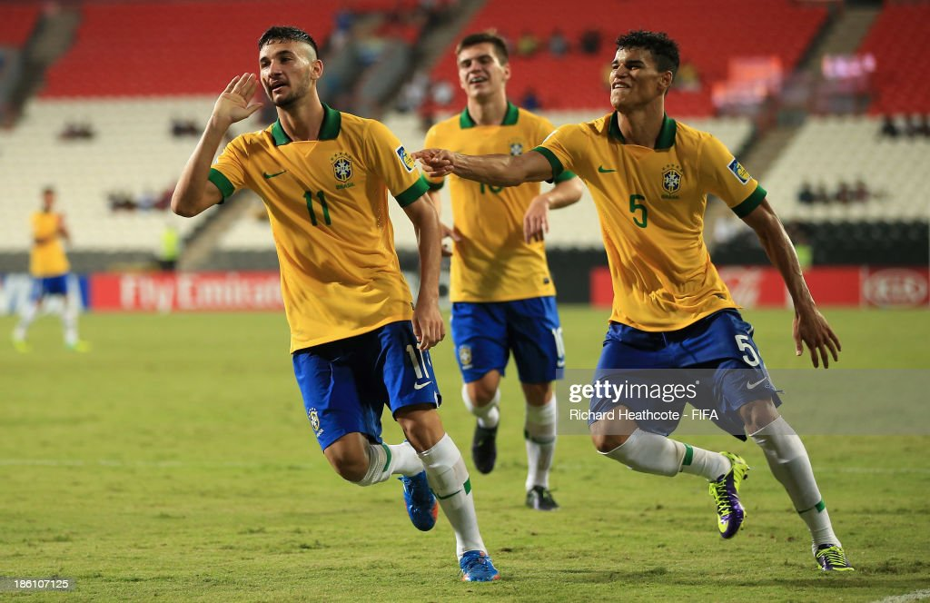 Boschilia of Brazil celebrates scoring the third goal during the FIFA U-17 World Cup UAE 2013 Round of 16 match between Brazil and Russia at the Mohamed Bin Zayed Stadium on October 28, 2013 in Abu Dhabi, United Arab Emirates.