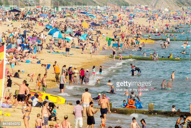 boscombe beach, dorset, uk. - crowded beach stock pictures, royalty-free photos & images