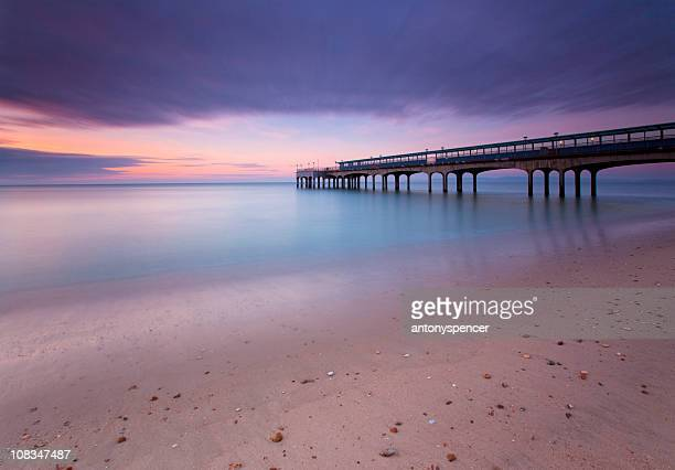 boscombe pier, bournemouth, twilight. - pebble stock photos and pictures