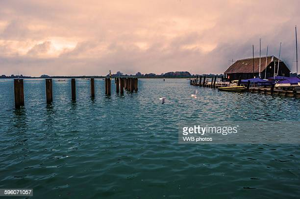 Bosham Pier and boat house, Bosham, East Sussex