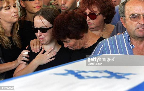 Bosmat and Rachael Avisaf the sister and mother of 28yearold Roey Avisaf one of 13 Israelis killed in the Sinai Desert bombing attacks mourn during...