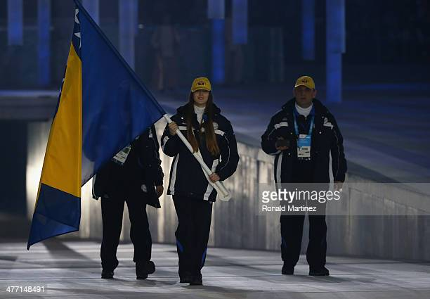 Bosnia and Herzegovina enter the arena lead by flag bearer Illma Kazazic during the Opening Ceremony of the Sochi 2014 Paralympic Winter Games at...