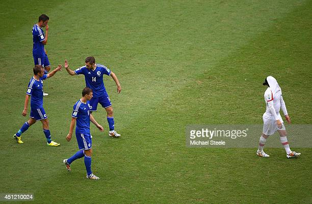 Bosnia and Herzegovina players celebrate their team's second goal during the 2014 FIFA World Cup Brazil Group F match between Bosnia and Herzegovina...