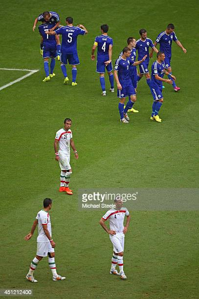Bosnia and Herzegovina players celebrate victory as Iran players lookd dejected after the 2014 FIFA World Cup Brazil Group F match between Bosnia and...