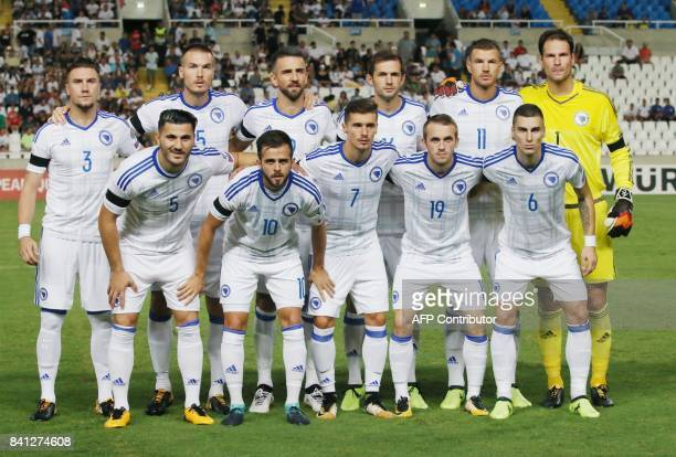 Bosnia and Herzegovina players pose for a family photo during their World Cup 2018 Europe qualifying match against Cyprus at the GSP Stadium in...