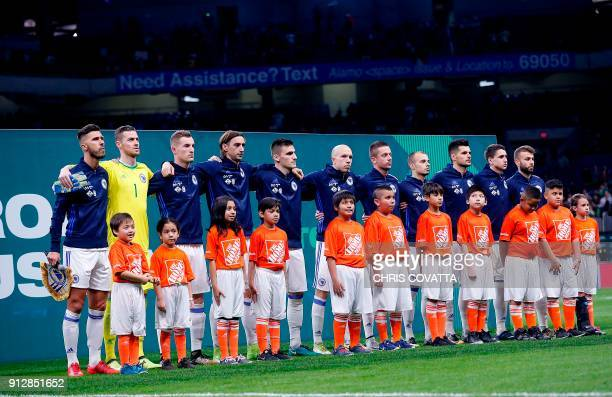 Bosnia and Herzegovina players stand together for their national anthem before playing Mexico in a friendly football game at the Alamodome in San...
